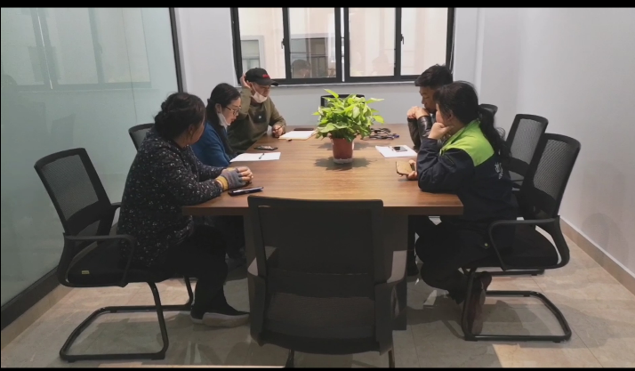 The boss and the staff of the design department held a special meeting